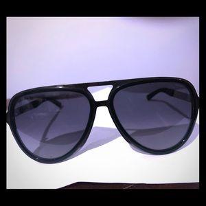 Used Gucci Aviator sunglasses with Gucci stripe